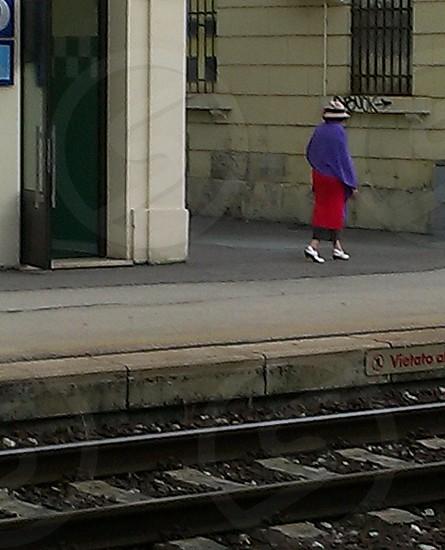 woman walking near train tracks photo