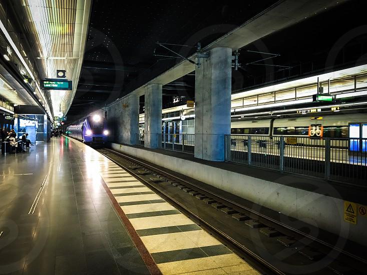 Railway train railway station transport transportation  travel traveling train station  platform  arrival photo
