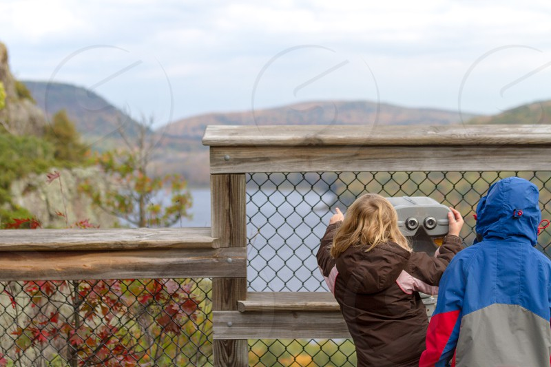 Children looking through the viewfinder at Lake of the Clouds in the Porcupine Mountains Michigan photo