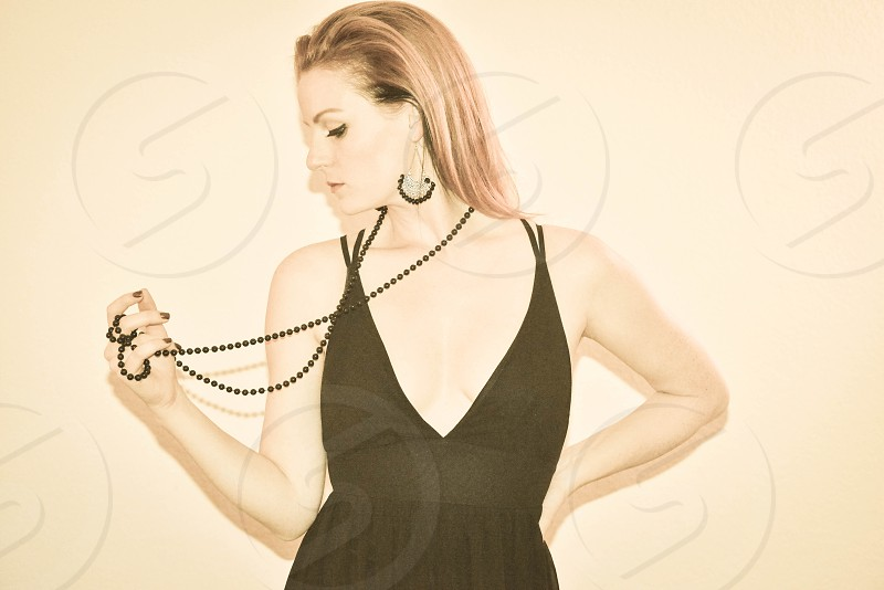 woman in black plunging neckline tank dress photo