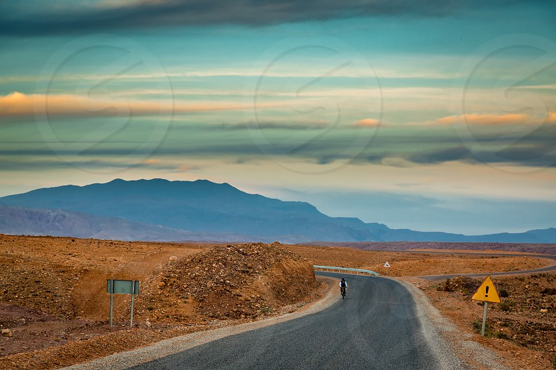 The road leading Atlas Mountains in Morocco. Roads in Morocco are in good technical condition. photo
