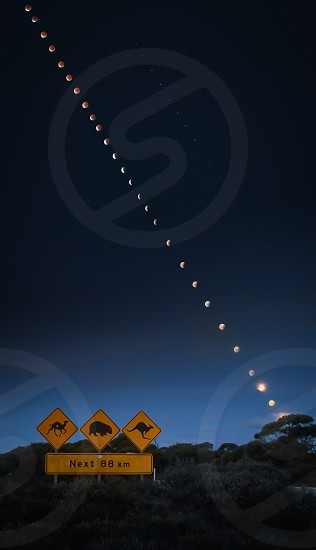 On the 4th of April I had my first chance to shoot a lunar eclipse. Unfortunately it wasn't a total one at this place in Australia. I made this picture over about 25 hours on the Eyre Highway at the border from South to Western Australia.  photo