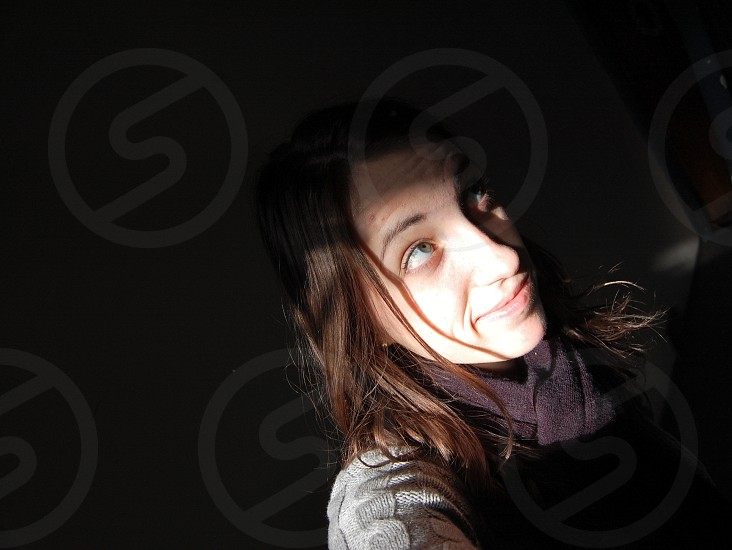Young woman in bright light photo