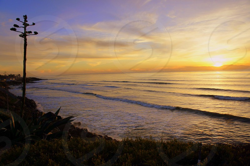 sunset over the ocean photo