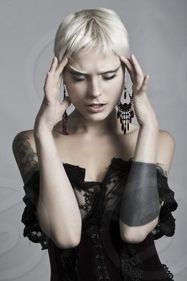 Model Portrait Beautiful Studio Fashion Tattoos Earrings Expression photo
