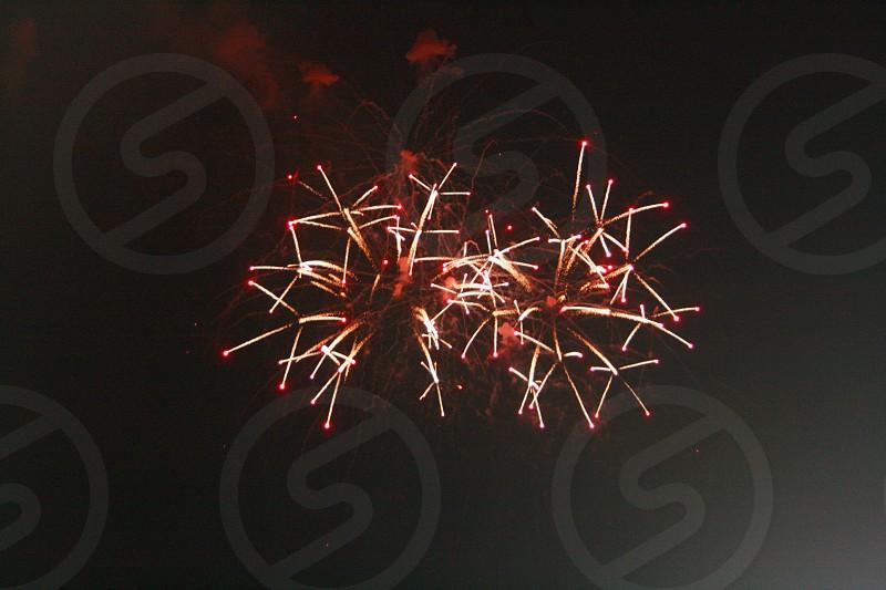 black sky orange fireworks photo
