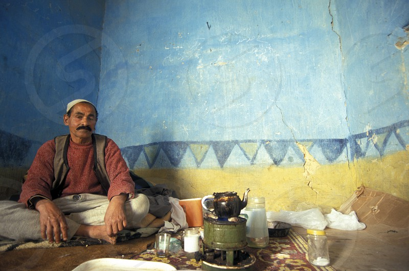 a men in his house in the old town of the Oasis and village of Siwa in the lybian or western desert of Egypt in north africa photo