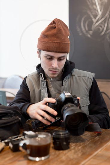 Job editorial - reviewing photos and videos at a coffee shop after a shoot. photo