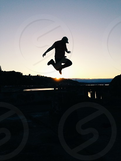man jumping silhouette photo photo