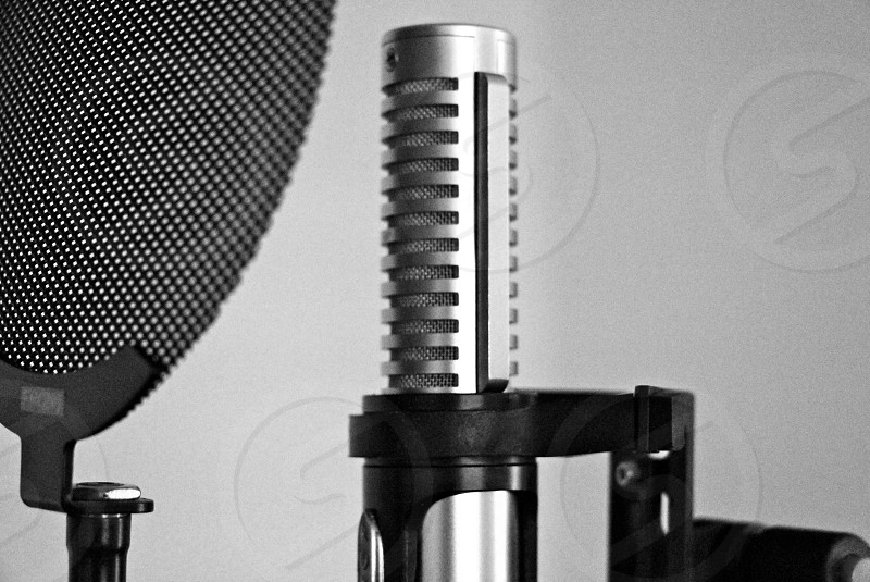 grey microphone with a black mic wind photo