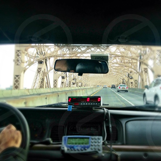 black rearview mirror in a taxi photo