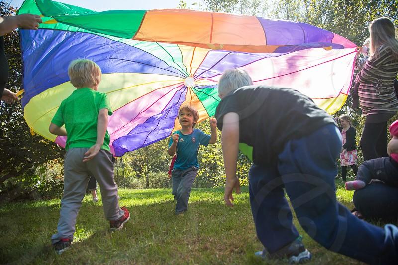 Children Running Under a Parachute photo