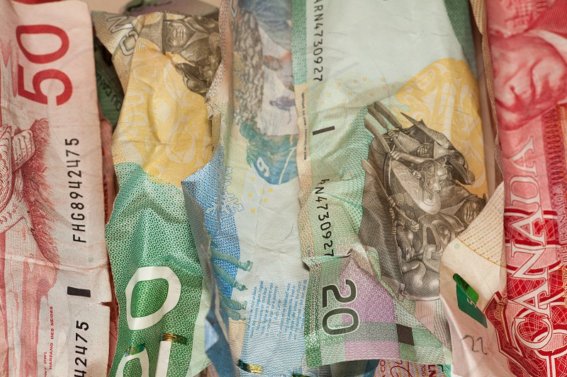 Crumpled Canadian dollar bills close-up currency crisis concept photo