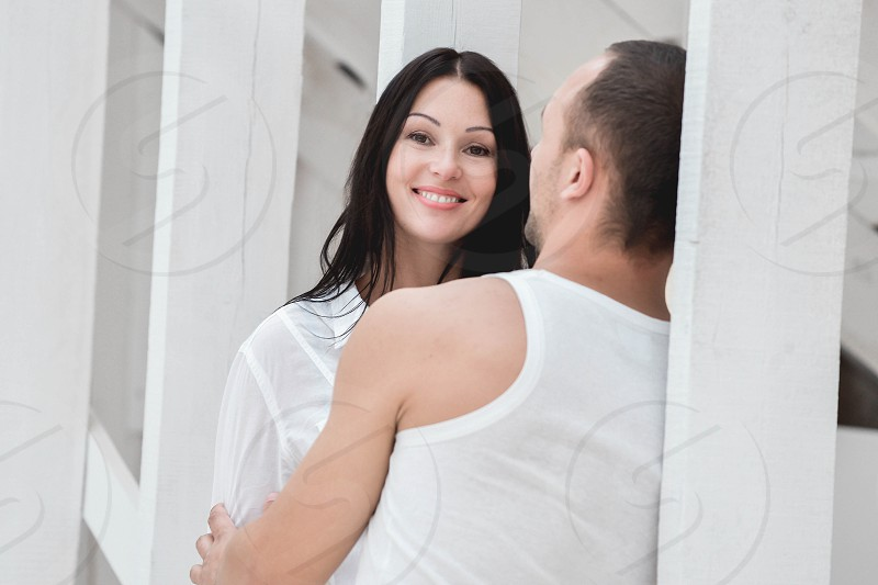 Young couple on in love at home standing. photo