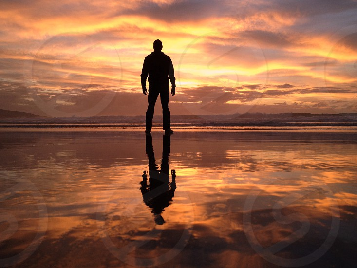 man standing over the sunset view photo