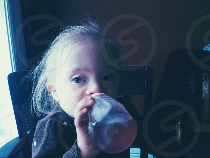 child's clear baby bottle photo