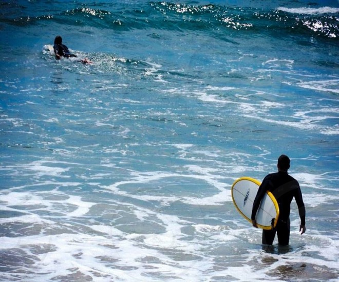 Outdoor day horizontal surf surfing surfers sea board colour California USA photo