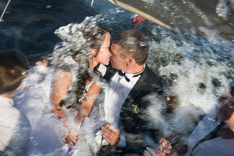 Wedding couple kissing  in water splashes photo