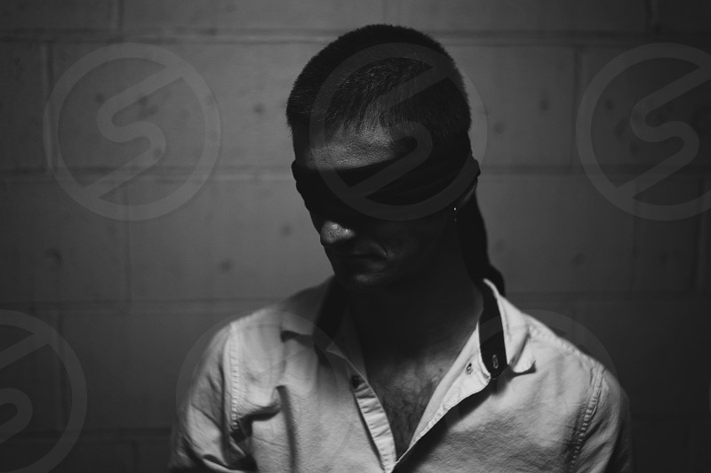moody black and white man blindfold  photo