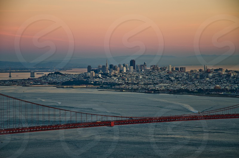 Night shot of city of San Francisco in California with part of Golden Gate Bridge on foreground photo