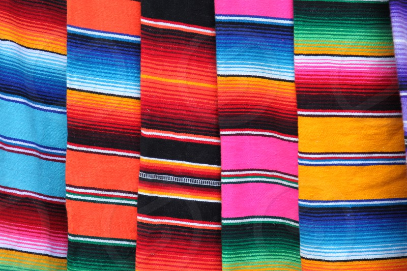 Mexico poncho serape Mexican background rug poncho fiesta cinco de mayo with stripes fabric textile material photo