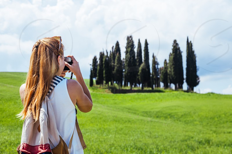 Young woman traveling through Tuscany Italy photo