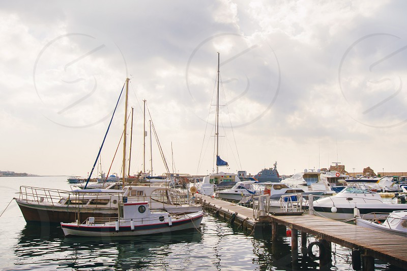 Boats in Paphos harbour Cyprus photo