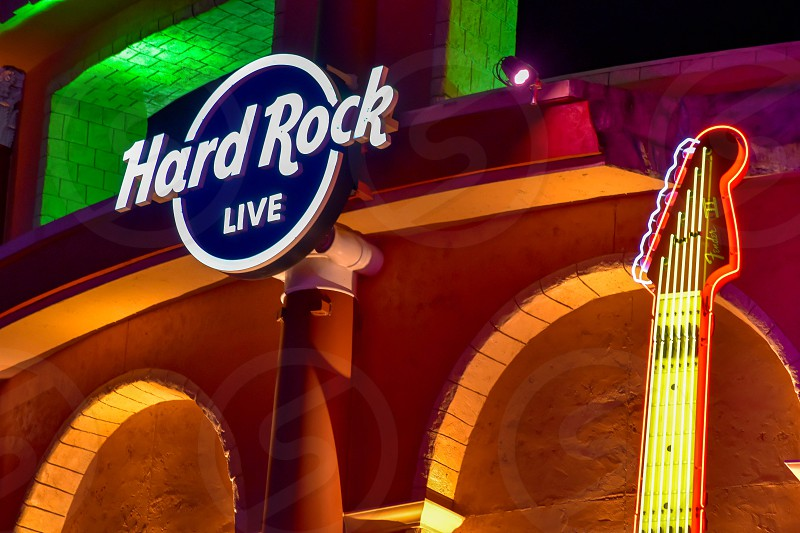 Orlando Florida. February 05 2019.  Hard Rock Live sign and partial view of guitar on colorful building background in Citywalk at Universal Studios area. photo
