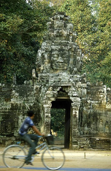 a Gate at the Angkor Thom temple in Angkor at the town of siem riep in cambodia in southeastasia.  photo