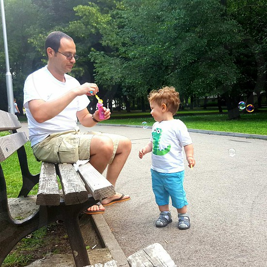 #father #son #happy #play #bubbles #park photo