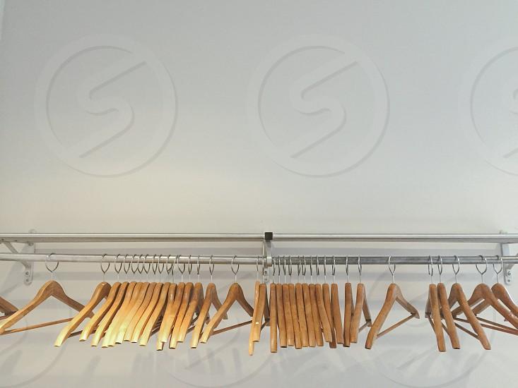 Closet wood hangers white walls photo
