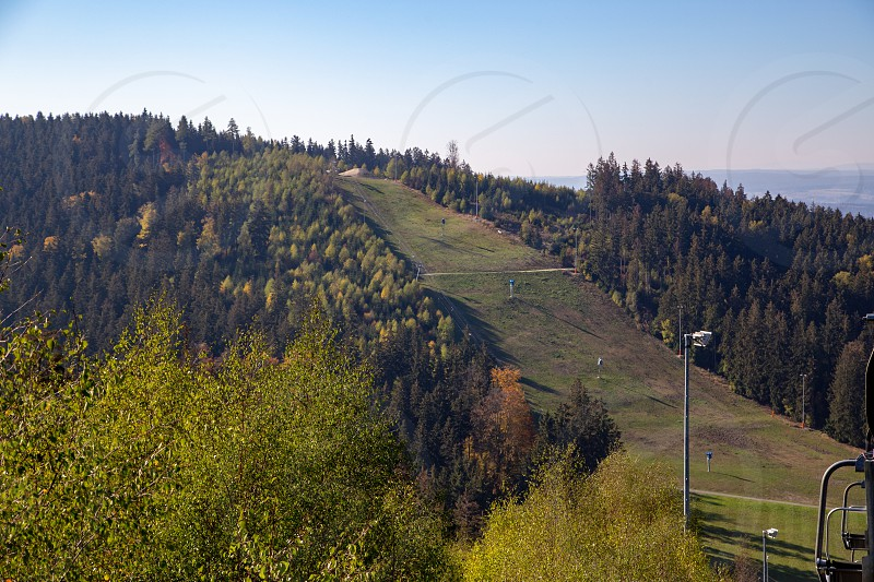 the ski slope with the cable car in summer in Schöneck in the Vogtland region in Saxony photo