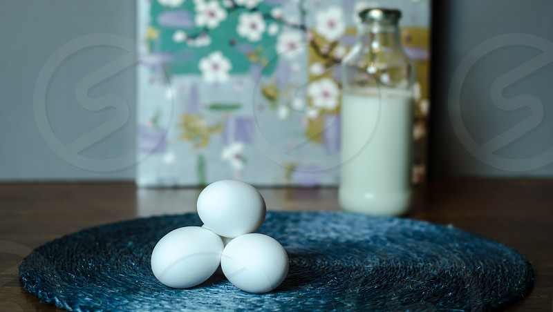 eggs mat blue background milk glass jar art fine art spring flowers white door landscape natural light food photo