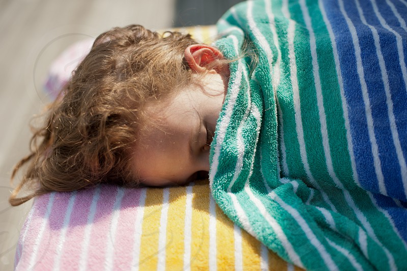 Girl wrapped in colorful towels photo