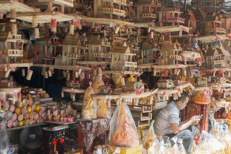 a shop with spirit houses at the central market or Psar Thmei market in the city of Phnom Penh of Cambodia.  Cambodia Phnom Penh November 2017 photo