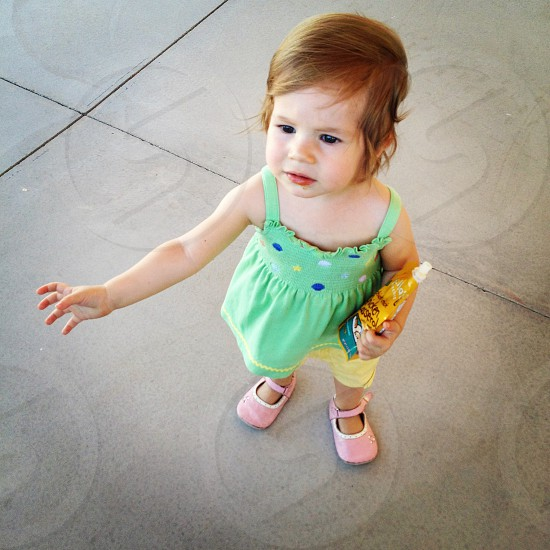 baby's green tank top blouse with pink mary jane shoes photo
