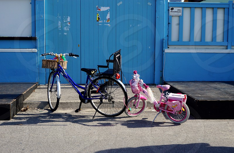 parked bikes parent and children family ride sunny day photo