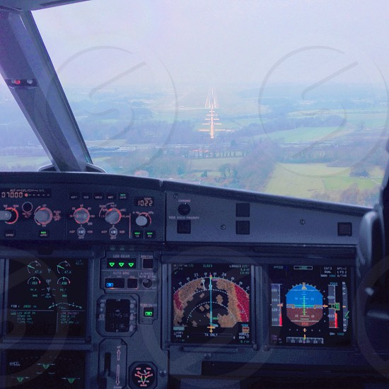 Final approach into Geneva Airport from an Airbus A319. photo