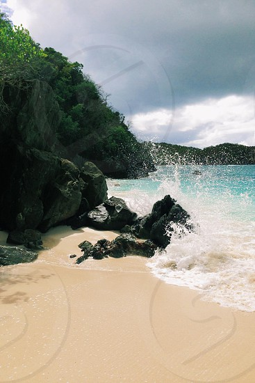 picture of a beach with large rocks photo