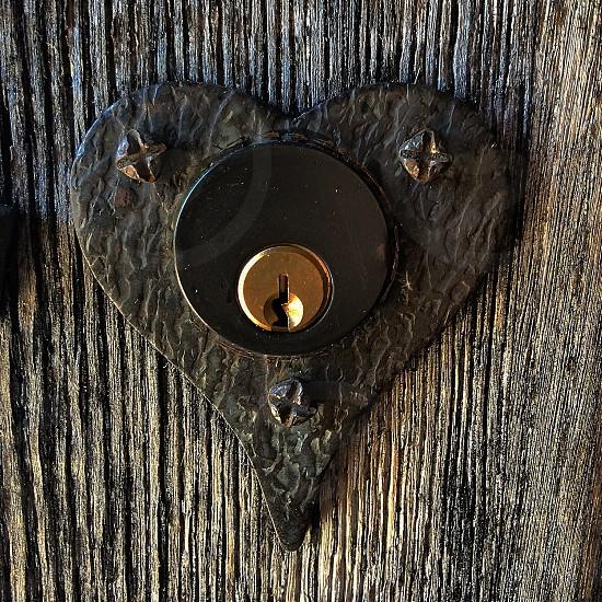 black heart shaped door lock photo