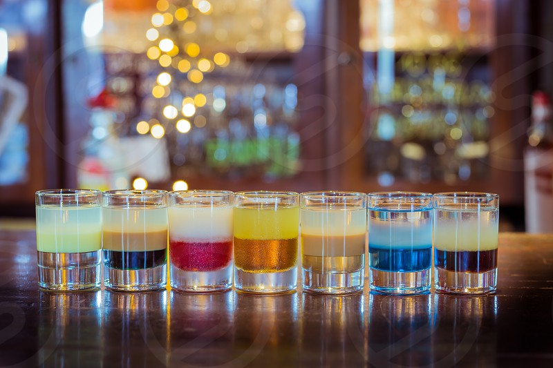 Multi layered colorful vodka shots. photo