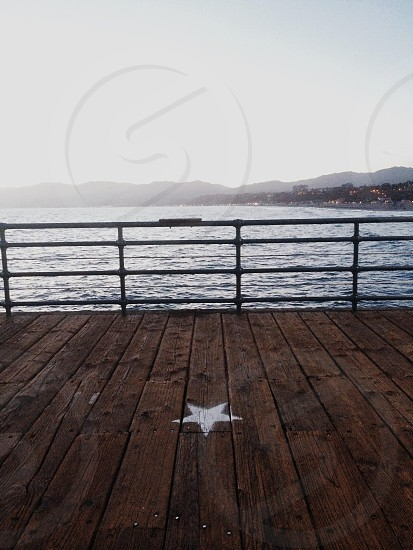 white star printed brown wooden dock photo