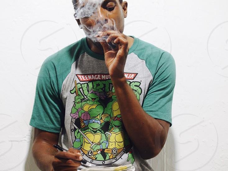 man smoking a cigarette photo
