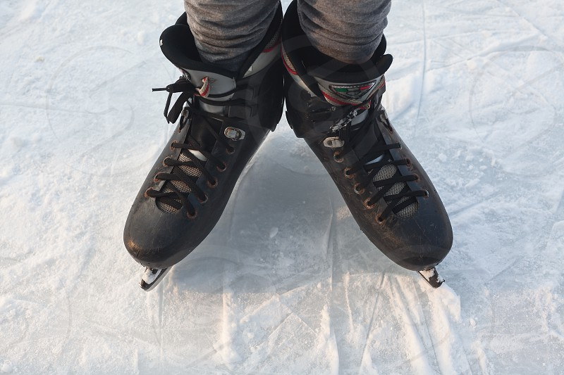 Two legs in skates on ice winter season and sport activities.  photo