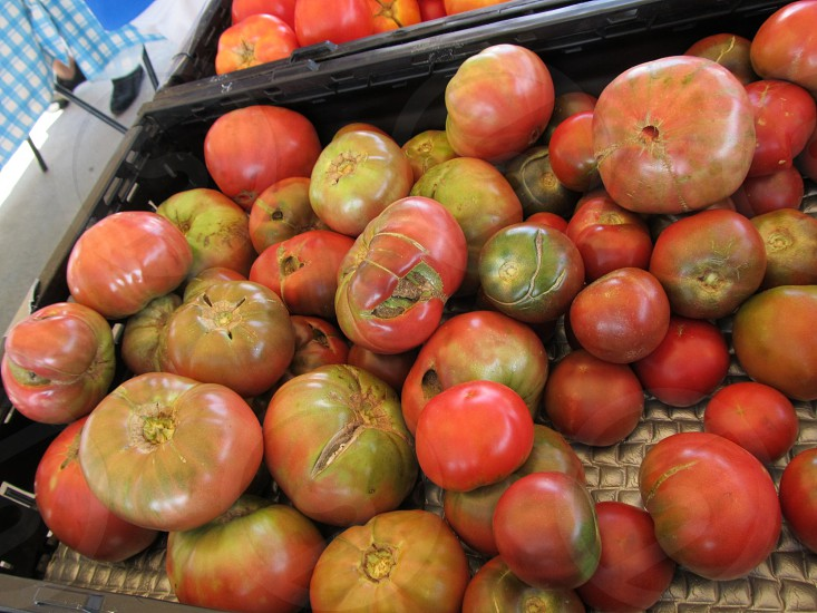 Heirloom tomatoes in crate at farmers market photo