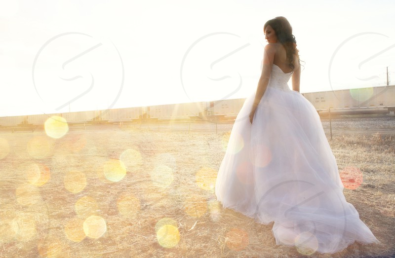 white ball gown wedding dress with tulle skirt and strapless top photo