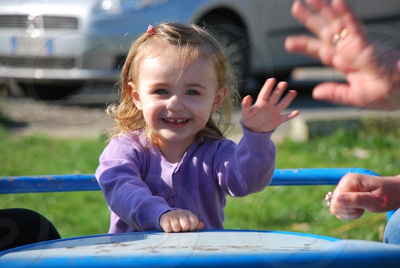 Baby greeting at playground. photo