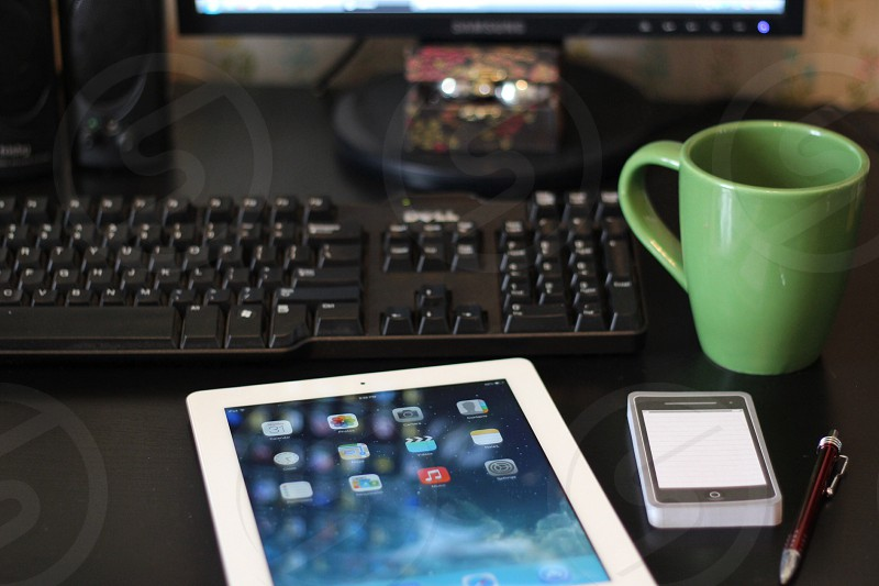 white ipad mini and green ceramic coffee mug photo