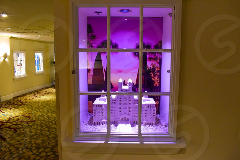 St. Pete Beach Florida. January 25 2019. The Hotel Don Cesar in miniature  behind the window. The Legendary Pink Palace of St. Pete Beach. photo