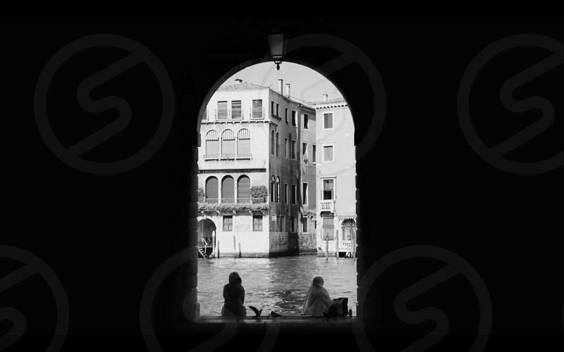 woman in arch door on ocean photograph  photo